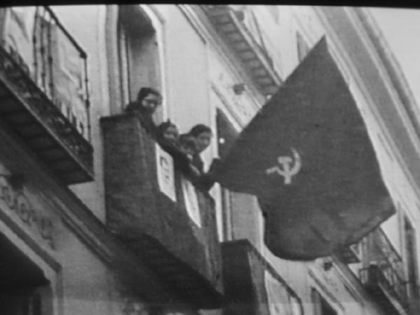 Soviet flag the soviet flag unfurled over the streets of madrid